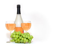 Wine For Two. Bottle of wine, 2 glasses of wine and bunch of grapes over white Royalty Free Stock Photos