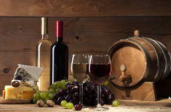 Wine with various types of cheese on wooden background Royalty Free Stock Photography