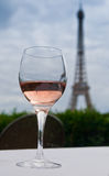 Wine With a View. A glass of wine enjoyed with a view of the famous Eiffel Tower as seen from the Trocodero in Paris, France Stock Photo