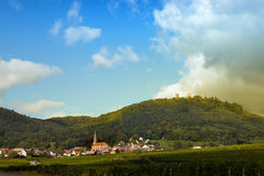 Wine village of Husseren-les-chateaux. Fortified castles and village of Husseren-les-Chateaux famous wine village along the wine route in Alsace, France Stock Photos