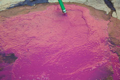 Wine vinasse rich in tartaric acid in magenta pink Stock Image