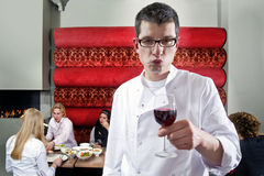 Wine waiter. A wine waiter tasting a good glass of wine royalty free stock photography