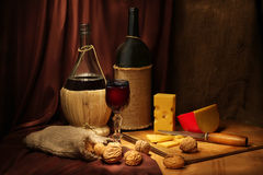 Wine and walnuts Stock Images