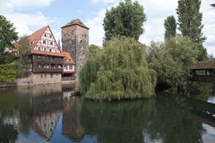 Wine Warehouse, Water Tower and the Bridge of the executioner on the river Pegnitz. Nuremberg. Germany. Stock Photo