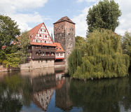 Wine Warehouse, Water Tower and the Bridge of the executioner on the river Pegnitz. Nuremberg. Germany. Royalty Free Stock Photography