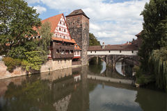 Wine Warehouse, Water Tower and the Bridge of the executioner on the river Pegnitz. Nuremberg. Germany. Royalty Free Stock Photo