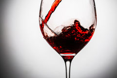 Wine waves at edges of crystal glass Stock Images
