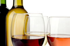 Wine on white background. Red, white and rose wine in bottles and wineglasses on white background Stock Photo