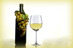 Wine in Wine Glass Near Green Glass Bottle stock image