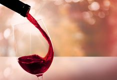 Wine. Glass pouring red  glass red  bottle stock images