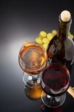 Wine and wineglass on black Royalty Free Stock Photography