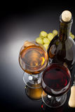 Wine and wineglass on black Stock Photography