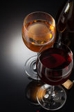 Wine and wineglass on black Stock Images