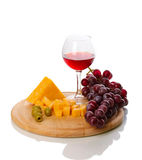 Wine in wineglass and cheese Royalty Free Stock Photography