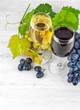 Wine in wineglass with grapes Stock Photo