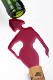 Wine woman. (wine flows from bottle Stock Photos