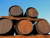 Wine wood casks. Wine oak casks on a blue sky Stock Images