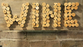 Wine. The word wine spelled with corks and hanging on wall Stock Photos