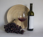 Winebottle with glass of bordeaux wine Royalty Free Stock Image