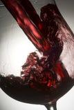 Wineglass 01. Red wine splashing in glass Stock Photos