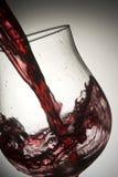Wineglass 03. Red wine splashing in glass Royalty Free Stock Photos