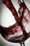 Wineglass 04. Red wine splashing in glass Stock Image