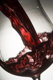 Wineglass 06. Red wine splashing in glass Royalty Free Stock Image