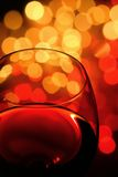 Wineglass. Close-up of wineglass with abstract lights background Royalty Free Stock Photo