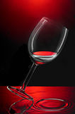 Wineglass. On water and a red backdrop Stock Image