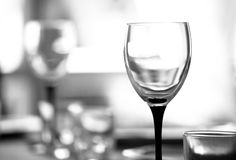 Wineglass. Against blurry background. Shallow DOF. Black and white tone stock images