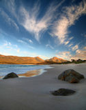 Wineglass Bay: the beach. The beach at Wineglass Bay, Tasmania. A nice scenic beach with lovely clouds Stock Images