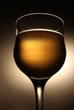 Wineglass with beverage Royalty Free Stock Image