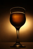 Wineglass with beverage Stock Photos