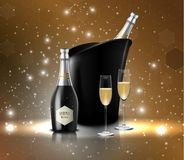 Wineglass with black wine bottles of champagne in a bucket Stock Image