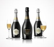 Wineglass with black wine bottles of champagne Royalty Free Stock Photography