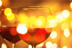 Wineglass on bokeh background. Wine christmas candle holiday dining candlelight royalty free stock photos