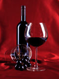 Wineglass and bottle. Lifestyle concept by wineglass and bottle , grape on red stock image