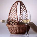 Wineglass and bottle in basket Stock Photo