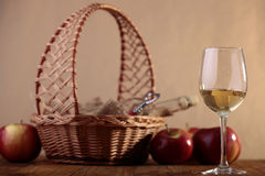Wineglass and bottle in basket Stock Photography