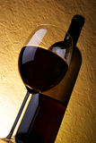 Wineglass and bottle of red wine Royalty Free Stock Images