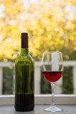 Wineglass and bottle on table Royalty Free Stock Photo