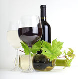 Wineglass, bottle of wine and leaf Royalty Free Stock Photo