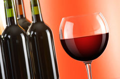 Wineglass and bottles of red wine. Composition with wineglass and bottles of red wine Stock Photos