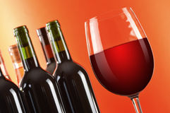 Wineglass and bottles of red wine Royalty Free Stock Image