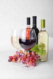 Wineglass, bottles of wine Royalty Free Stock Image