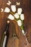 Wineglass with bouquet of white tulips, wooden background. Wineglass with bouquet of white tulips on the wooden background Stock Image