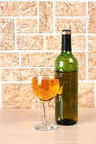Wineglass on brick Royalty Free Stock Photos
