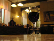 Wineglass in cafe. Evening stock photography