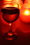 Wineglass and candles Royalty Free Stock Photography