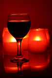 Wineglass and candles Royalty Free Stock Images